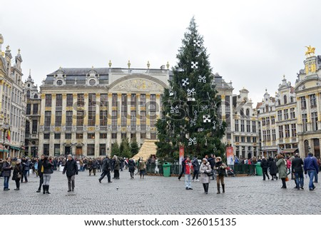 BRUSSELS, BELGIUM-DECEMBER 5, 2014: Grand Place of Brussels with installed Christmas Tree, decorated with symbols of Riga, capital of Latvia - stock photo