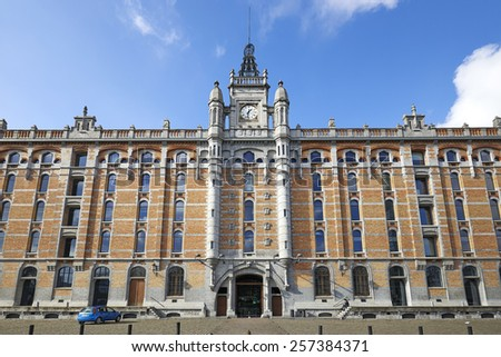 BRUSSELS, BELGIUM - FEBRUARY 22, 2015: Tour et Taxis, Thurn en Taxis  is a large formerly industrial site, example of the quality of 19th century architecture in Brussels, Belgium. - stock photo