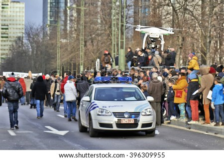 BRUSSELS, BELGIUM - JANUARY 11, 2015: A drone flying over the Brussels event against terrorism and support for freedom of expression after the attacks against the magazine Charlie hebdo - stock photo