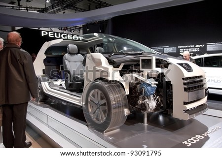 BRUSSELS, BELGIUM - JANUARY 12: Annual autosalon brussel 2012 auto motor show in Heysel  expo hall. Open Peugeot 3008 HYbrid4 concept car on display.  January 12, 2012 in Brussels,  Belgium