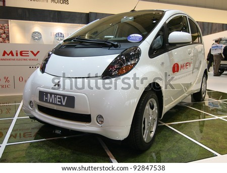 BRUSSELS, BELGIUM - JANUARY 15: Mitsubishi iMiev electric car shown at Euro Motors 2012 exhibition on January 15, 2012 in Brussels, Belgium - stock photo
