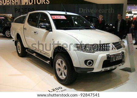 BRUSSELS, BELGIUM - JANUARY 15: Mitsubishi L200 pickup shown at Euro Motors 2012 exhibition on January 15, 2012 in Brussels, Belgium - stock photo