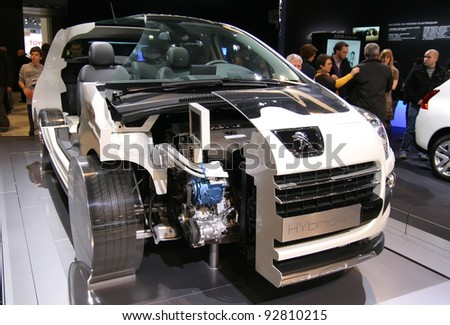 BRUSSELS, BELGIUM - JANUARY 15: Peugeot 3008 hybrid car with case open shown  at Euro Motors 2012 exhibition on January 15, 2012 in Brussels, Belgium - stock photo