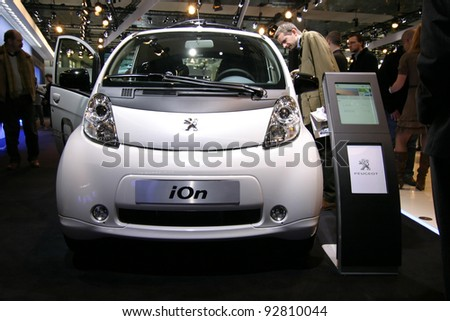 BRUSSELS, BELGIUM - JANUARY 15: Peugeot iOn electric car shown at Euro Motors 2012 exhibition on January 15, 2012 in Brussels, Belgium - stock photo