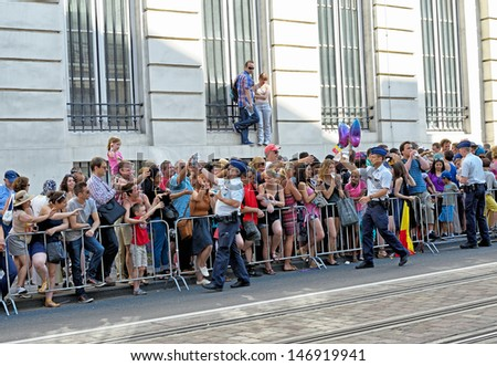 BRUSSELS, BELGIUM - JULY, 21: Belgian police distributes packages with water for visitors during National Day of Belgium with unusually hot weather on July 21, 2013 in Brussels.