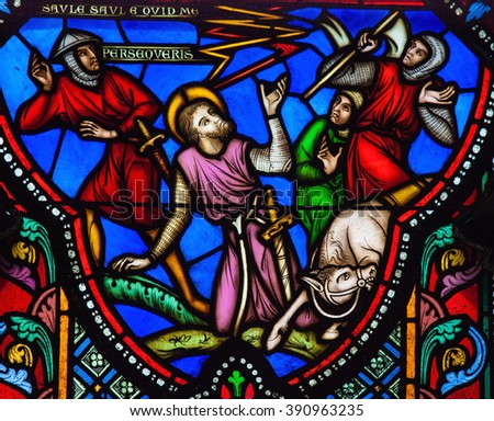 BRUSSELS, BELGIUM - JULY 26, 2012: Conversion of Paul the Apostle on a Stained Glass in the Saint Gudula Cathedral in Brussels, Belgium. - stock photo
