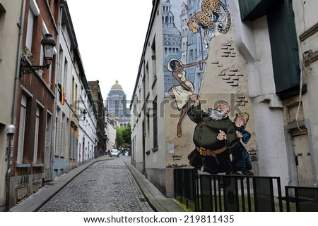 BRUSSELS, BELGIUM - JULY 11: Filtered picture of a comic strip mural painting on July 11, 2014 in Brussels, Belgium. Brussels is known as a homeland of comic strips and is full of comic murals. - stock photo