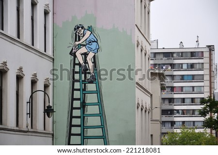 BRUSSELS, BELGIUM - JULY 11: Filtered picture of a comic strip mural painting on July 11, 2014 in Brussels, Belgium. Brussels is known as a homeland of comic strips and is full of comic murals.