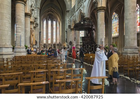 BRUSSELS, BELGIUM - JULY 4, 2015: Interior of gothic cathedral of Notre Dame de Sablom, at the time a wedding was taking place.
