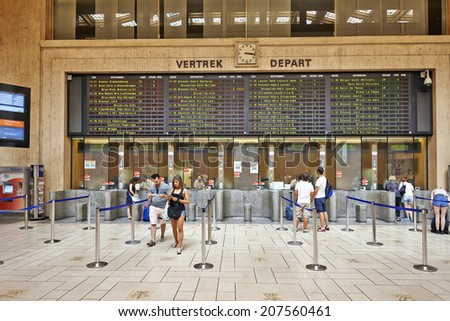 BRUSSELS, BELGIUM - JULY 27, 2014: Interior of the main lobby of Brussels Central Train Station on July 27, 2014 in Brussels , Belgium. People are waiting for their ticket - stock photo