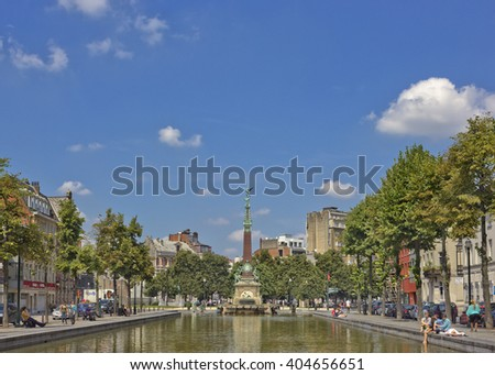 BRUSSELS, BELGIUM - JULY 17, 2014: Jules Anspach fountain and street Quai aux Briques in a bright sunny day  - stock photo