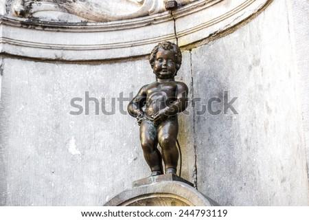 BRUSSELS, BELGIUM - JULY 6: Manneken Pis statue in Brussels. Statue of a pissing boy in a beautiful summer day in Brussels, Belgium on July 6 2014 - stock photo