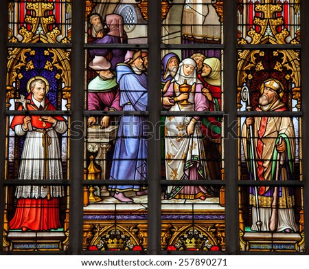 BRUSSELS, BELGIUM - JULY 26, 2012: Stained Glass window depicting Saint Carolus Borromeus, Saint Eugenius and un unidentified saint in the Cathedral of Brussels, Belgium. - stock photo