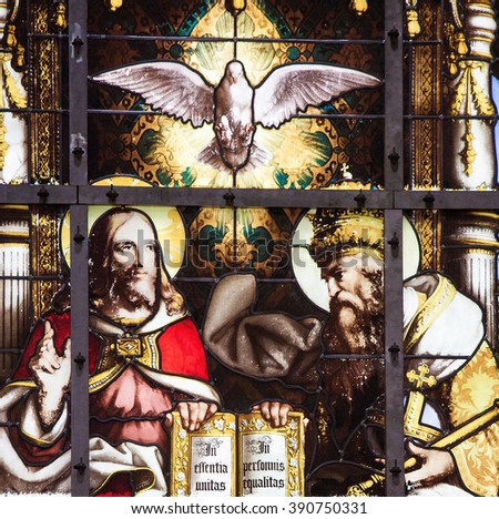 BRUSSELS, BELGIUM - JULY 26, 2012: Stained Glass window of the Holy Trinity, Father, Son and Holy Spirit, in the Cathedral of Brussels, Belgium. - stock photo
