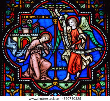 BRUSSELS, BELGIUM - JULY 26, 2012: Stained Glass window of the Prophet Daniel and the Archangel Gabriel in the Cathedral of Brussels, Belgium. - stock photo
