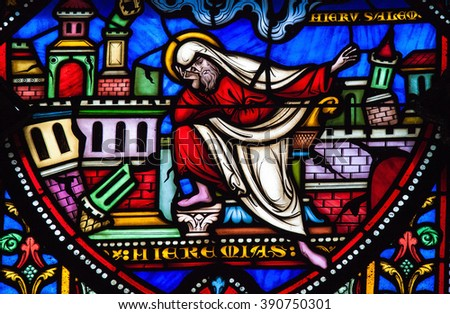 BRUSSELS, BELGIUM - JULY 26, 2012: Stained Glass window of the prophet Jeremiah lamenting the destruction of Jerusalem in the Cathedral of Brussels, Belgium. - stock photo