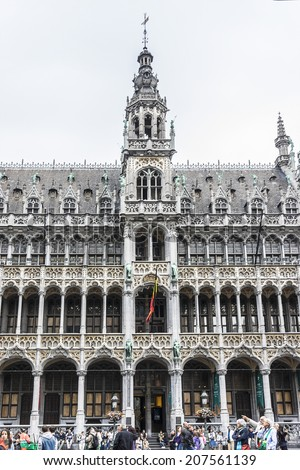 BRUSSELS, BELGIUM - JUNE 19, 2014: Many tourists visiting famous Grand Place (Grote Markt) - the central square of Brussels. Grand Place was named by UNESCO as a World Heritage Site in 1998.
