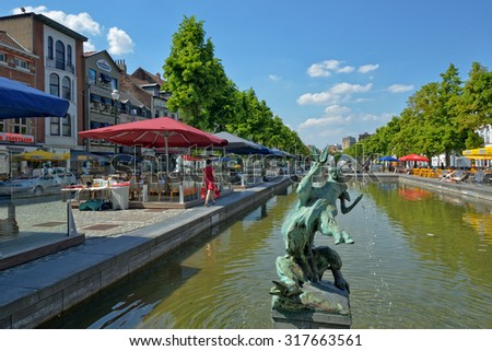 BRUSSELS, BELGIUM-JUNE 06, 2013: Quai de Bois a Bruler square, which was built on place of the old port. Favorite place for tourists searching Belgian sea food restaurants - stock photo