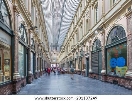 BRUSSELS, BELGIUM - JUNE 16, 2014:  Royal Galeries of st. Hubert. The galleries was opened in year 1846.  - stock photo