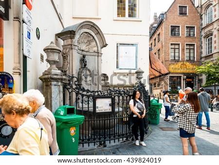 BRUSSELS, BELGIUM - June 16, 2016. The famous statue of a pissing boy of Brussels, Belgium, one of the most popular tourist destinations in brussel, Belgium. - stock photo