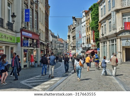 BRUSSELS, BELGIUM-JUNE 6, 2015: Tourists walk in historical center of Brussels near Central railway station