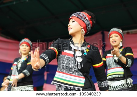 BRUSSELS, BELGIUM-JUNE 10: Unidentified dancers show national dance from Philippines during Asia & U festival on June 10, 2012 in Brussels. This is annual festival of Asian cultures in Belgium. - stock photo