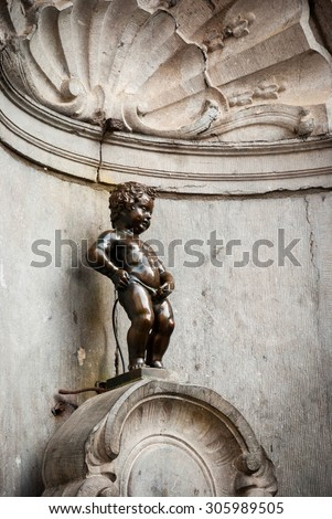 BRUSSELS, BELGIUM - MARCH 16 - Manneken Pis, Little man pee or le petit Julien the iconic landmark of Brussels on March 16, 2015 - stock photo