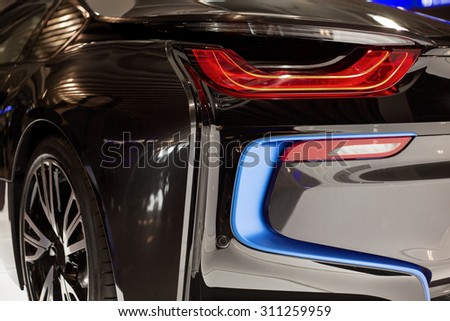 BRUSSELS, BELGIUM - MARCH 25, 2015: Rear lamps of BMW i8, the newest generation plug-in hybrid sports car developed by BMW. - stock photo