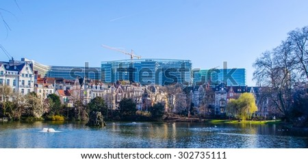 BRUSSELS, BELGIUM, MARCH 9, 2014: View over the artificial lake with fountain in front of the european commission building in brussels.