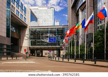 BRUSSELS, BELGIUM - MAY 20, 2015: European Parliament offices and European flags. - stock photo