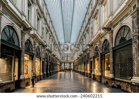 BRUSSELS, BELGIUM - MAY 11, 2014: Evening in Royal Galleries Saint Hubert. The galleries opened in 1847 and are one of main attractions of city. - stock photo