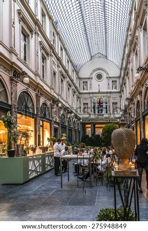 BRUSSELS, BELGIUM - MAY 11, 2014: Evening in Royal Galleries Saint Hubert. The galleries opened in 1847 and are one of main attractions of city.