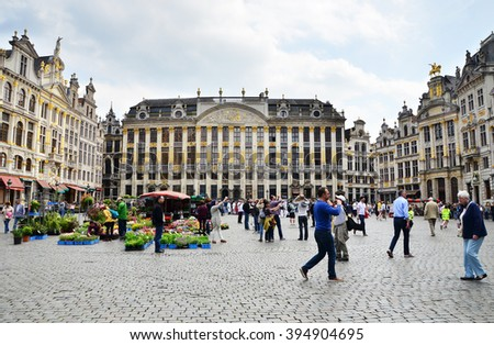 Brussels, Belgium - May 13, 2015: Many tourists visiting famous Grand Place of Brussels. The square is the most important tourist destination and most memorable landmark in Brussels.  - stock photo