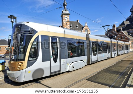 BRUSSELS, BELGIUM - MAY 25, 2014: New type of Brussels tram waiting at the terminus in front of the Schaerbeek station in Brussels