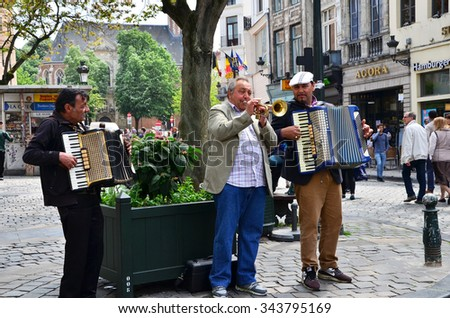 Brussels, Belgium - May 12, 2015: Street musician at Place d'Espagne (Spanish Sqaure) in Brussels, Belgium. on May 12, 2015. - stock photo