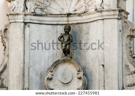 BRUSSELS, BELGIUM - MAY 1, 2013: The Manneken Pis (Le Petit Julien) is the most iconic statue of Belgium