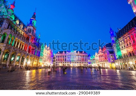Brussels, Belgium - May 13, 2015: Tourists visiting famous Grand Place the central square of Brussels. The square is the most important tourist destination and most memorable landmark in Brussels.  - stock photo
