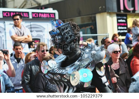 BRUSSELS, BELGIUM-MAY 19: Un unknown participant demonstrates his costume of a robot at Zinneke Parade on May 19, 2012 in Brussels. This parade is an artistic biennial urban free-attendance event. - stock photo