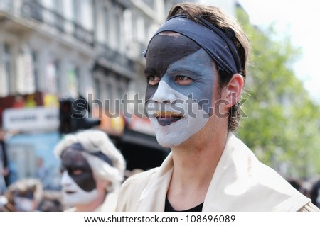 BRUSSELS, BELGIUM-MAY 19: Unidentified participant shows complex makeup during Zinneke Parade on May 19, 2012 in Brussels, Belgium. This parade is a biennial urban artistic and free-attendance event. - stock photo