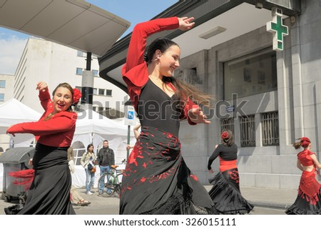 BRUSSELS, BELGIUM-MAY 5, 2013: Unidentified participants demonstrate flamenco dances during annual Day of Iris - Fete de l'Iris in Brussels.