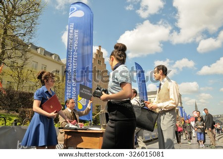 BRUSSELS, BELGIUM-MAY 5, 2013: Unidentified performers play scene in Le Mont des Arts parc during annual Day of Iris - Fete de l'Iris in Brussels - stock photo
