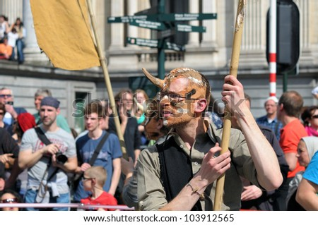 BRUSSELS, BELGIUM-MAY 19:  unknown participant shows his costume of devil during Zinneke Parade on May 19, 2012 in Brussels. This parade is a biennial urban artistic and free-attendance event. - stock photo