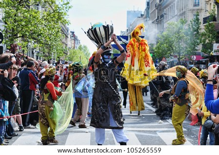 BRUSSELS, BELGIUM-MAY 19: Unknown participants show their mystic performance at Zinneke Parade on May 19, 2012 in Brussels. This parade is an artistic biennial urban free-attendance event. - stock photo