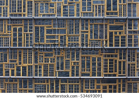 Brussels, Belgium - October 12, 2016: The facade of the Bloc A of the Europa Building in Brussels, Belgium, is a patchwork of traditional wood-frame windows from different European countries.