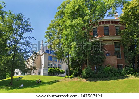 Brussels, Belgium, Park Leopold, people relaxing on the grass, sunny summer day - stock photo
