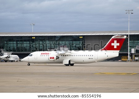 """BRUSSELS, BELGIUM - SEPT 17: A Swiss Air airplane lands at the airport in Brussels, Belgium on Sept. 17,  2011 in Brussels, Belgium. Swiss Airlines has been named """"Europe's Leading Airline Business Class"""" of World Travel Awards - stock photo"""