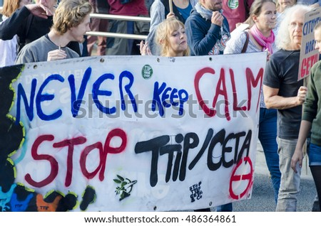 BRUSSELS, BELGIUM, SEPTEMBER 20: Activists and signs during the TTIP GAME OVER demonstration in Brussels. A call for direct actions on Free Trade Agreements such as TTIP CETA and TISA. Belgium 2016