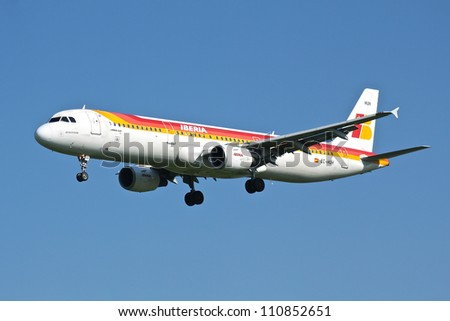 BRUSSELS, BELGIUM - SEPTEMBER 30: An Iberia Airbus 321-200 on final approach on September 30, 2011 in Brussels, Belgium. Iberia is the largest spanish airline with 24 million passengers in 2010. - stock photo