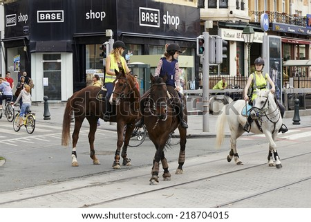 BRUSSELS, BELGIUM - SEPTEMBER 21, 2014:Bicyclist, joggers,skateboarder,horses and walkers enjoy Car Free Streets on Tervueren Ave as part of Brussels City's September 21, 2014 in Brussels, Belgium