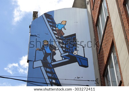 BRUSSELS, BELGIUM - SEPTEMBER 14, 2011: Comic strip mural painting on September 14, 2011 in Brussels, Belgium. Brussels is known as a homeland of comic strips and is full of comic murals. - stock photo